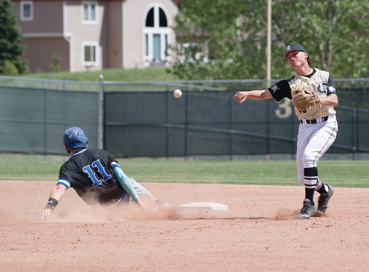 Rock Canyon's Jake Hammons, right, throws to first base after getting the tag on Grandview's Tyson Hayes at second base. The Jaguars defeated Grandview 8-1 in the first game and then took out Heritage in the district final 13-6.