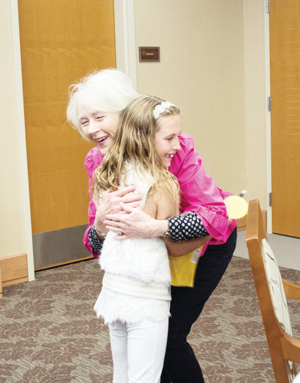 Sil Stenman hugs her pen pal Abby Brown upon meeting her for the first time on April 28 at the Holly Creek Retirement Community.
