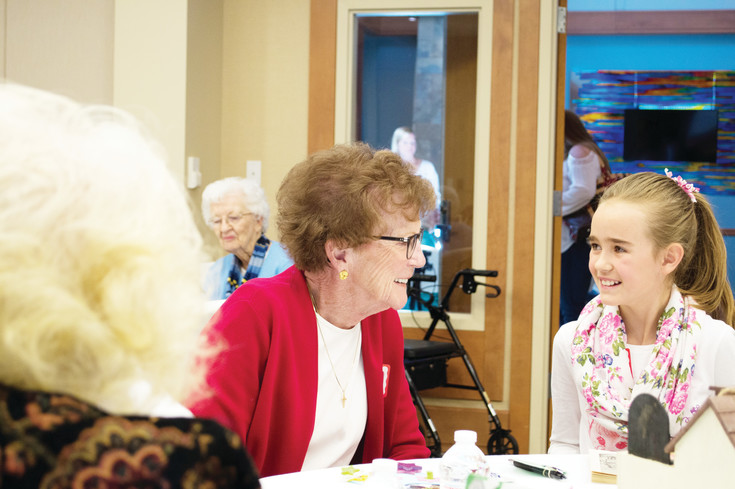 Phoebe Alfke interracts with her pen pal, Kayla Boerman, on April 28 at the Holly Creek Retirement Community.