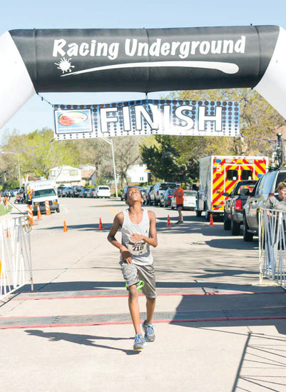 Micai Shoots, 14, was the overall winner of the adult male division with a time of 19:50.