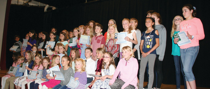 All the winners — kindergarten through 12th grade — pose as a group for a parents' photo op at the May 10 awards ceremony for the Education Nonprofit Corporation's (ENC) Jeffco Writing Challenge and I Love to Read Contest.