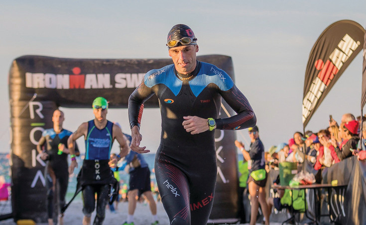 Tim Hola finishes an Ironman Triathlon, consisting of a 2.4-mile swim, a 112-mile bicycle ride and a 26.2-mile run, according to ironman.com. The Highlands Ranch resident has competed in more than 200 triathlon races internationally.