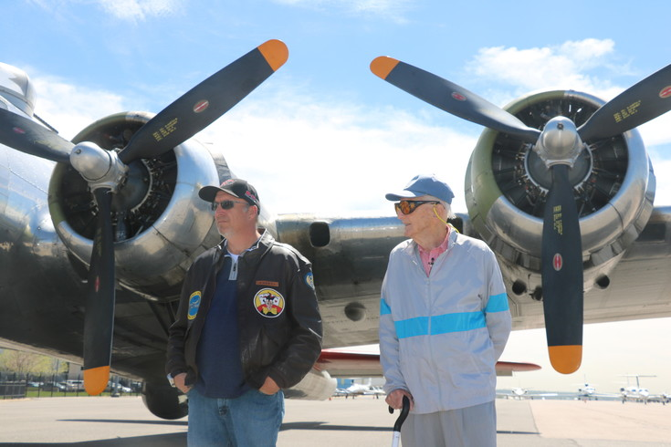 Scott Maher, director of flight operations at The Liberty Foundation, and World War Ii veteran Robert McAdam, stand before the Madras Maiden. The foundation owns the plane, and takes it around the country to show people the piece of history.
