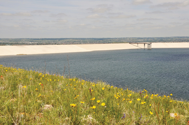 A photo courtesy of the Parker Water and Sanitation District shows the unrefined landscape surrounding the Rueter-Hess Reservoir. An intergovernmental agreement between the Towns of Parker and Castle Rock, passed by the Parker town council on May 1, laid the groundwork for paddle boarding and tours of the reservoir to begin this summer.