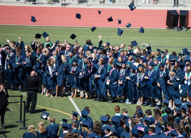 The graduates threw their caps in the air to complete the graduation ceremony at Echo Park Stadium on May 16.