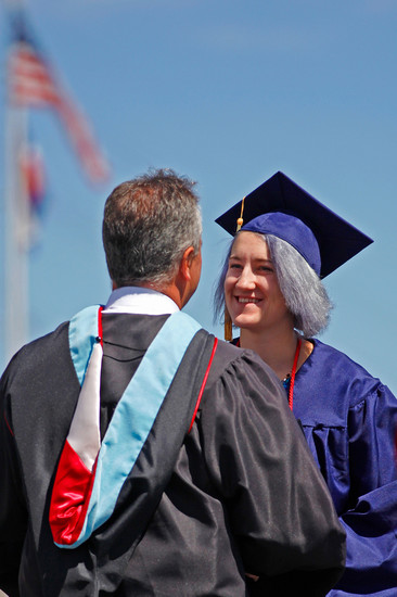 "Chaparral High School graduate Kara Jessica Wilkes shakes hands with Principal Greg Gotchey during the school's graduation ceremony on May 17. Gotchey told graduates they would always be part of the ""Chap family."""