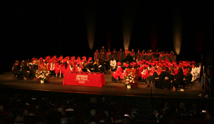 "Jefferson High School's class of 2017, seated, listen as the school's choir performs ""Seize The Day"" by the Newsies during the graduation ceremony on May 17 at Ellie Caulkins Opera House in downtown Denver."