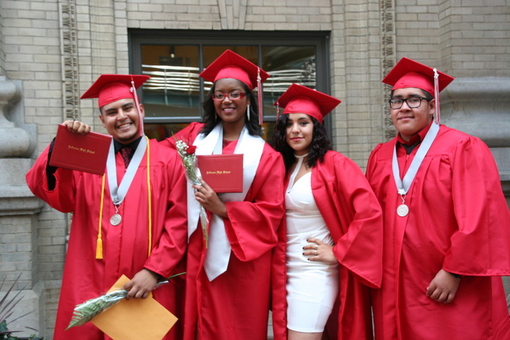 Jefferson High School's graduates, from left, Ramses Quezada, Janessa Kiome, Savanna Martinez and Edgar Serna smile following the 2017 graduation ceremony, which took place May 17 at Ellie Caulkins Opera House in downtown Denver.