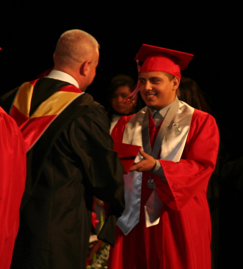 Jefferson High School Principal Michael James hands 2017 graduate Alexander Christian Solis his diploma at the school's graduation ceremony on May 17 at Ellie Caulkins Opera House in downtown Denver.