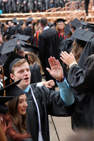 Seniors exchange high five's as they take their seats before the Castle View High School graduation begins. Photo by Jessica Gibbs