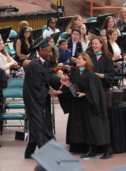 A student receives their diploma during the 2017 commencement ceremony for Castle View High School.