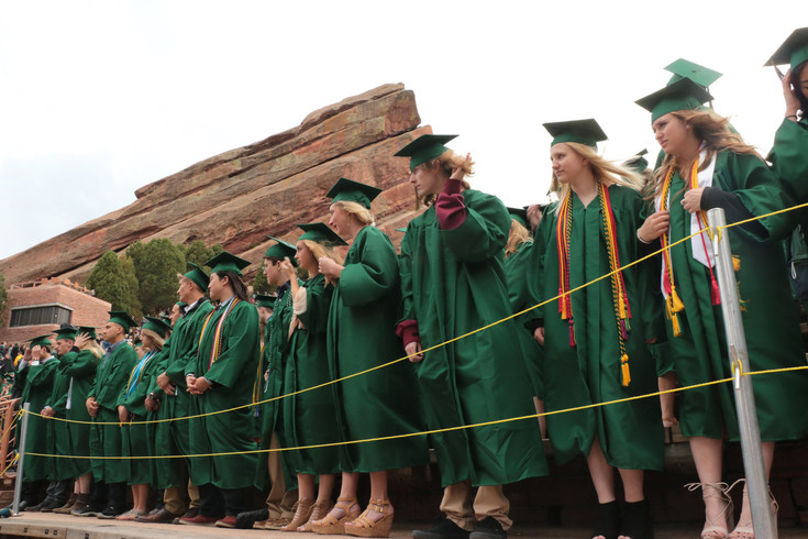 Mountain Vista High School graduates brave wind and rain at the 2017 commencement ceremony on May 17 at Red Rocks Amphitheatre.