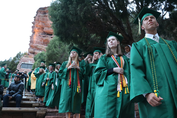 Mountain Vista High School graduates form a line along the steps of Red Rocks Amphitheatre as they anxiously wait to receive their diplomas. The May 17 commencement ceremony drew a full house to the scenic outdoor theater.