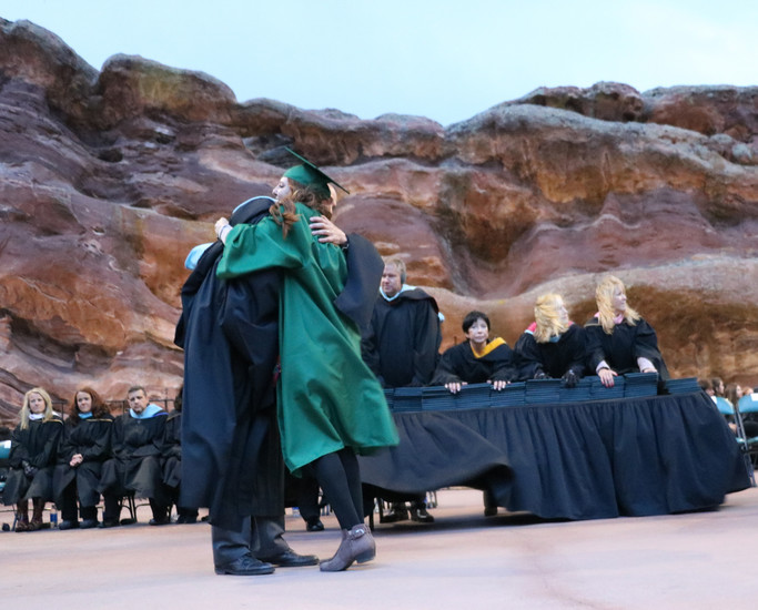 Mountain Vista High School Principal Michael Weaver hugs a graduate at the May 17 commencement ceremony held at Red Rocks Amphitheatre.