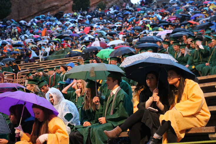 As Mountain Vista's May 17 commencement ceremony progressed into the evening, Red Rocks Amphitheatre became a sea of colorful umbrellas. Graduates, many whom were soaking wet by the end of the night, remained in good spirits, smiling and cheering on one another.