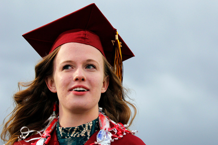 Under an overcast sky, Ponderosa High School graduate Lindsay Butler looks across the field at EchoPark Automotive Stadium on May 17. Butler wears a lei of candy bars fashioned by a friend from the Church of Latter Day Saints in Parker.