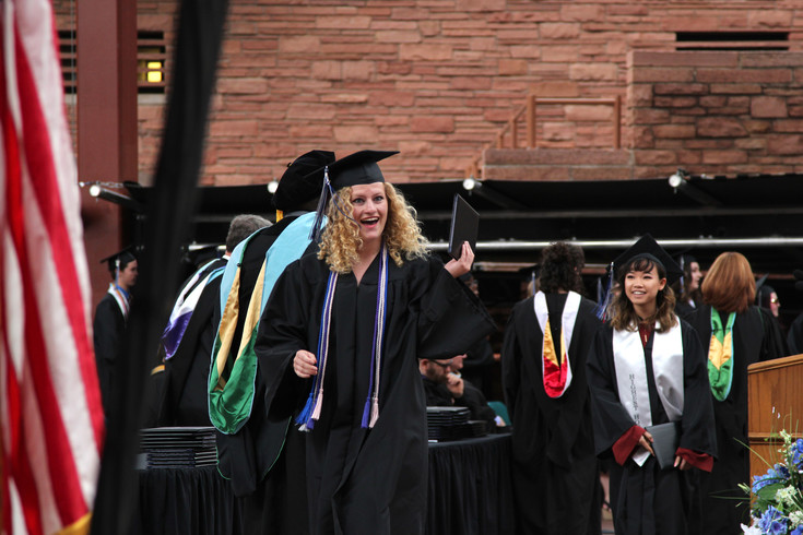 Seniors celebrate after receiving their diploma at the Highlands Ranch High School graduation ceremony at Red Rocks Amphitheater on May 17.