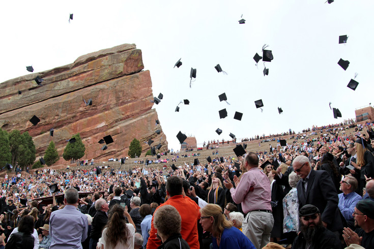 Graduates throw their hats at the conclusion of the Highlands Ranch High School graduation on May 17 at the Red Rocks Amphitheater.