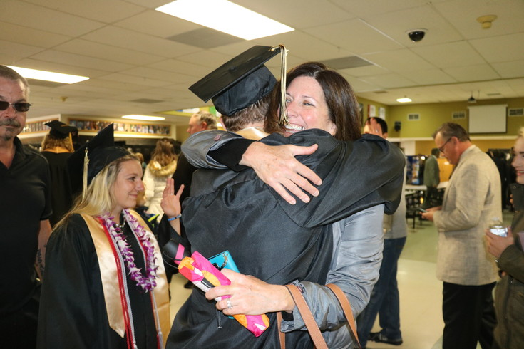 Before graduation begins at Green Mountain High School on May 18, family members got in one last hug and celebration with their students.