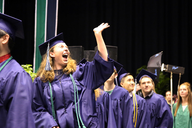 Jenny Pott waves to her family while entering the graduation floor May 18.