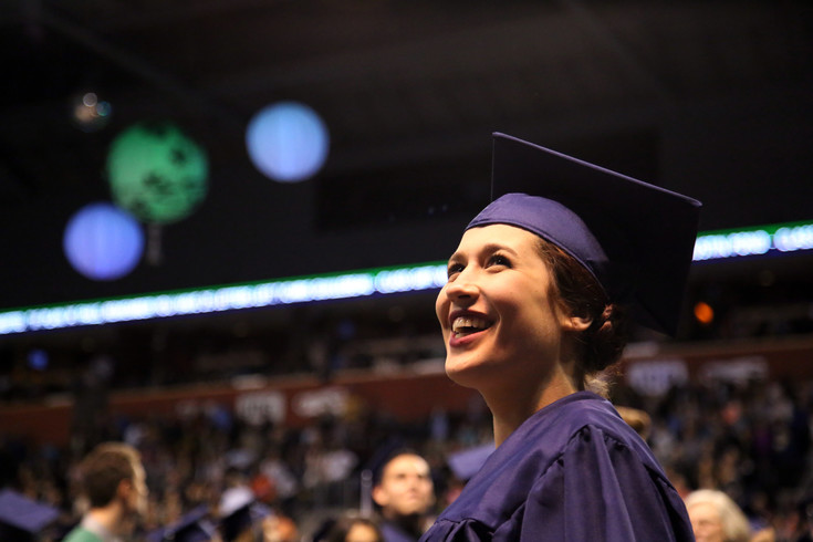 Shaine Stiefvater smiles as she walks into the Standley Lake High School graduation at the 1st Bank Center May 18.