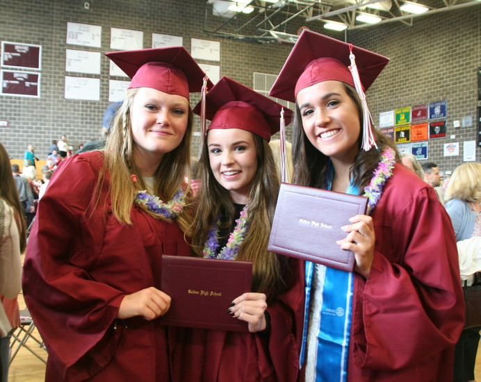 Golden High School graduates from left, Sadie Grimm, Samantha Lolk and Kate Morris proudly display their diplomas following the school's 144th commencement ceremony on May 19.