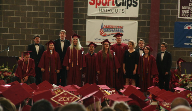 Golden High School 24th Street Singers entertain the 2017 graduates with song during the high school's 144th commencement ceremony at Golden High School on May 19.