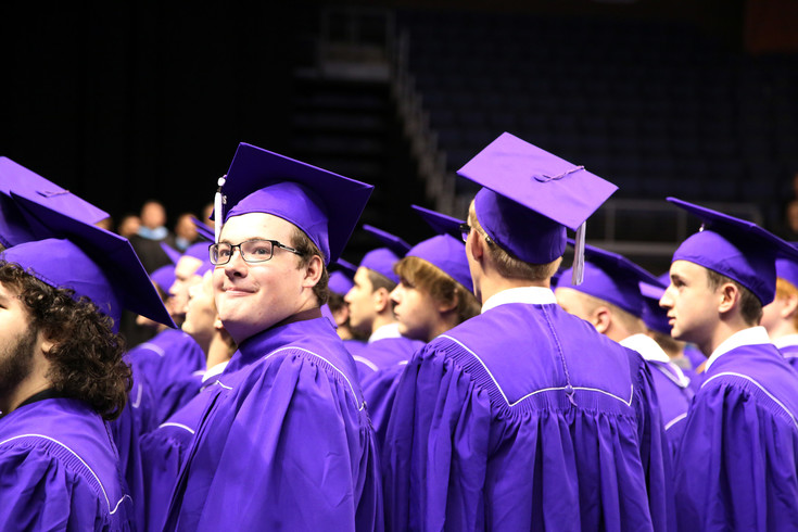 Jacob Fisher looks back in the audience before the Arvada West graduation ceremony begins.
