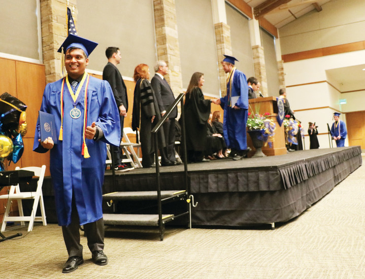 STEM School and Academy graduates receive their diplomas at a May 17 commencement ceremony held at the University of Colorado South Denver.
