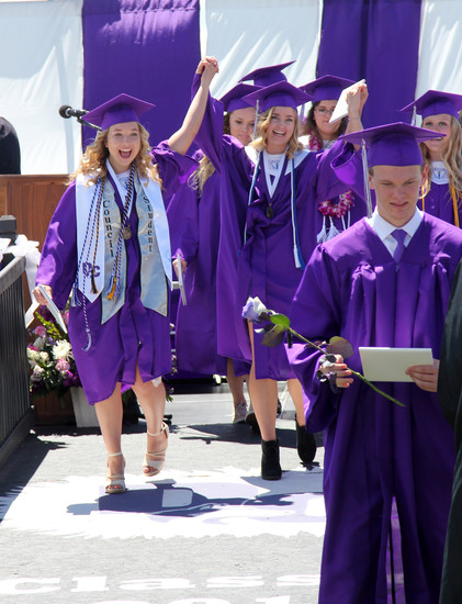 Graduates walk away with their diplomas after the Douglas County High School graduation ceremony.