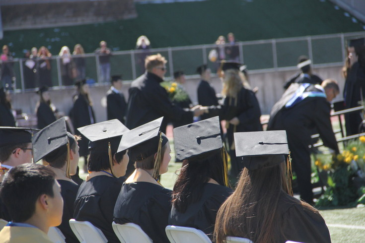 Graduate wait for their turn to receive their diplomas during Rock Canyon High School Graduation May 20.