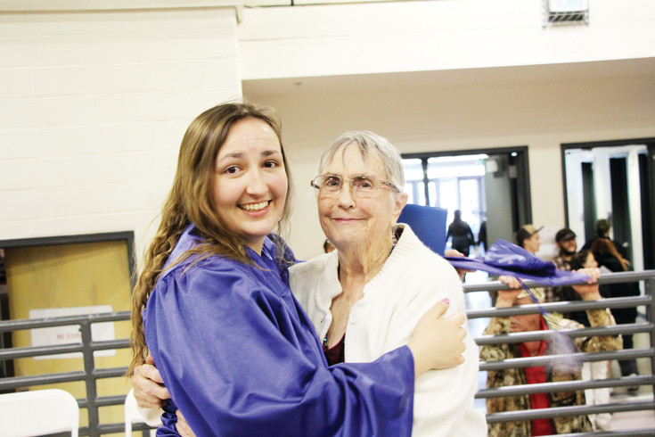 Englewood High School graduate Ashleigh Long hugs her grandmother Donna Larsen following the May 20 EHS commencement ceremonies. Because of bad weather earlier in the week the May 20 ceremonies were held in the Englewood High School Field House as 112 members of the Class of 2017 received their diplomas.