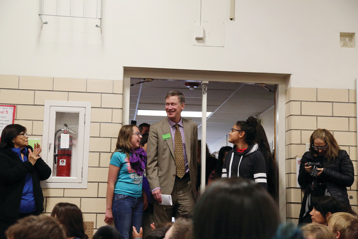 Governer John Hickenlooper arrives at Foster Elementary to sing two bills into law.