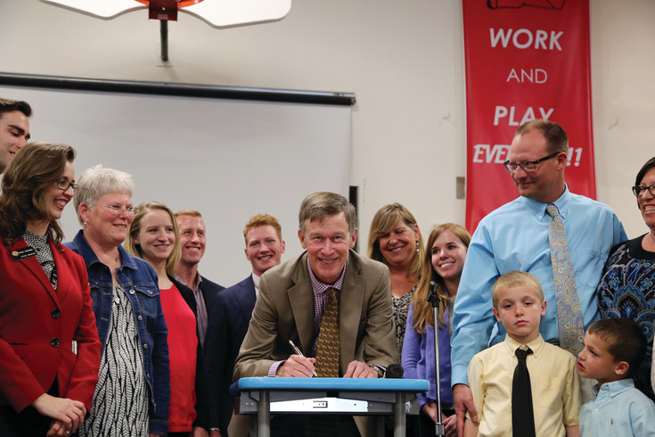 Governer John Hickenlooper signed two bills into law at Foster Elementary School May 18.