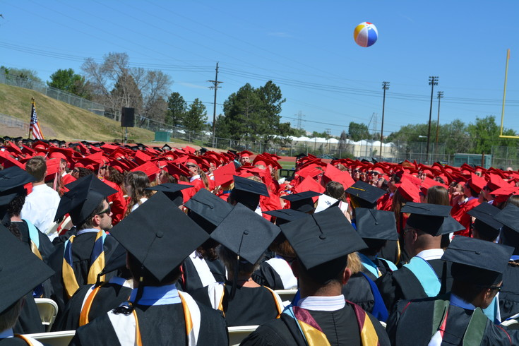Heritage High School seniors bat around a beach ball while waiting to become graduates. Photo by Kyle Harding