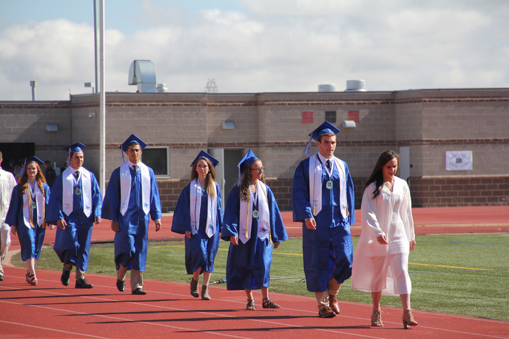 Legend High School graduates enter EcoPark Automotive Stadium in Parker May 26 for the 2017 graduation ceremony.