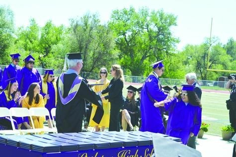 Isabel Guzman gets ready to recieve her diploma at the Littleton High School graduation on May 26 at the Littleton Public Schools Stadium.