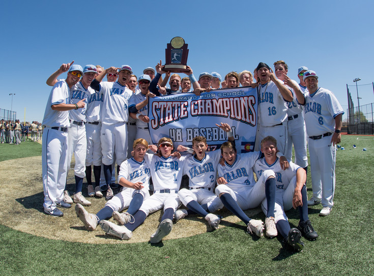 Valor Christian's baseball team raise their new Championship banner and trophy to celebrate winning their second 4A State Final.  The Eagles defeated Evergreen 7-3 at Metro State University in Denver on Sunday. Photo by Paul DiSalvo