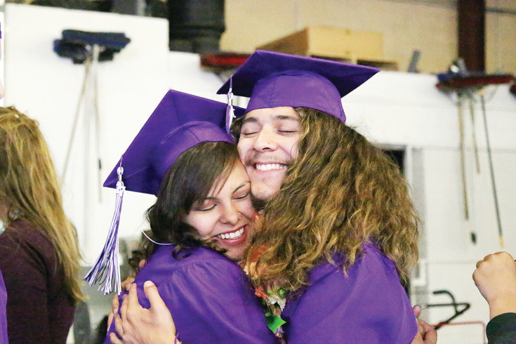 Graduates Justice Gallegos and Solomon Ulibarri hug each other at the Long View High School graduation.
