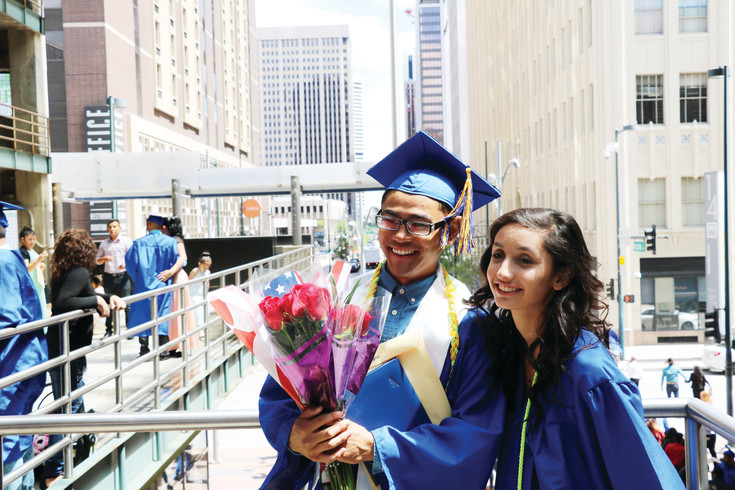 Alameda High School seniors celebrate their graduation with family and friends after the ceremony at the Ellie Caulkins Opera House on May 23.