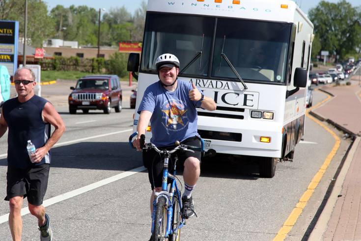 Brad Gagon, of the Arvada Police Department, ride with the Law Enforcement Torch Run June 1.
