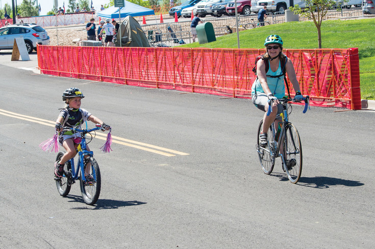 Zoe Konrad and Alison Riffel of Boulder make the turn crossing the finish line in the 8 Mile Family Course during the 30th annual Subaru Elephant Rock Cycling Festival.  The cycling event was held in Castle Rock over the June 3-4 weekend and was based at the Douglas County Fairgrounds.