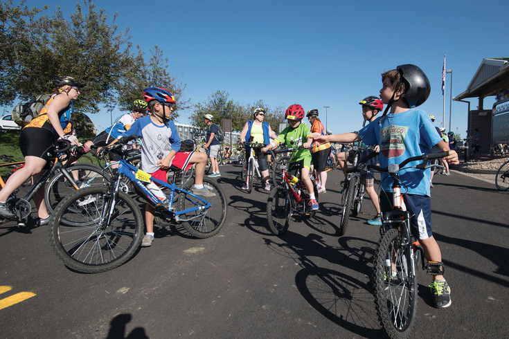 Some of the younger riders discuss course strategy just prior to the launch of the 8 Mile Family Course during the 30th annual Subaru Elephant Rock Cycling Festival.  The cycling event was held in Castle Rock over the June 3-4 weekend and was based at the Douglas County Fairgrounds.