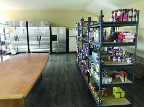 Harvest Bible Church of Elizabeth accommodates the food pantry and food bank on the upper level of its building, with large refrigerators and shelves purchased with a grant from the Food Bank of the Rockies.