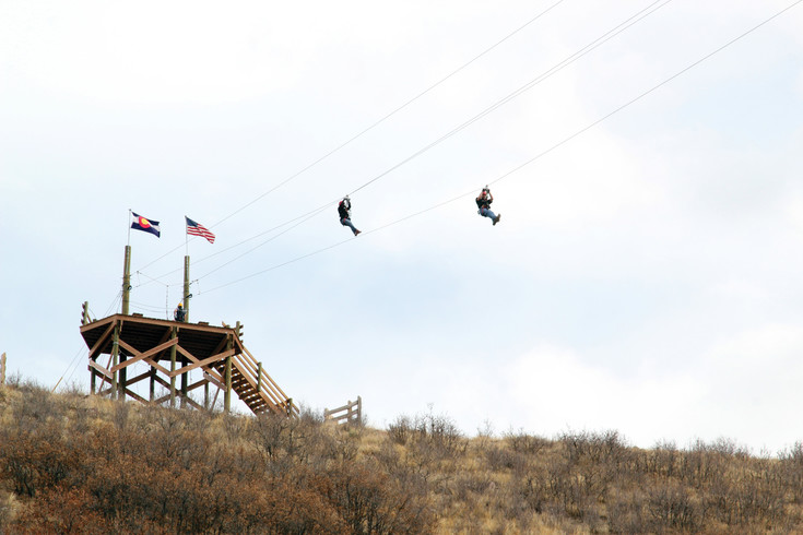 Those taking advantage of the Castle Rock Zipline Tours fly overhead at Philip S. Miller Park.