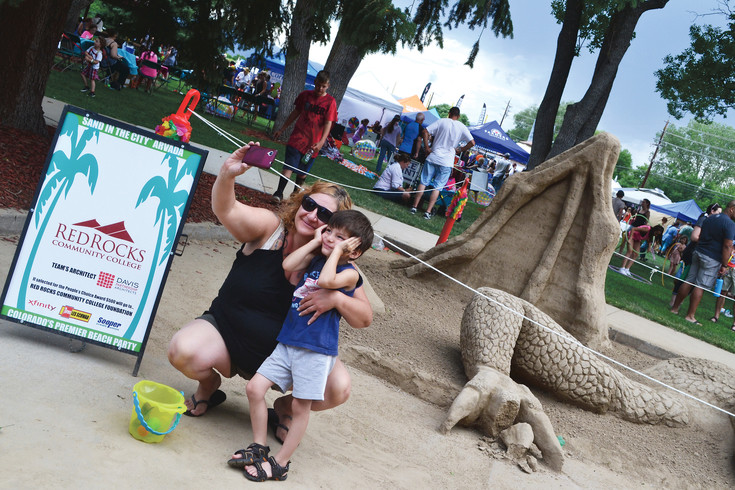 """I like this one,"" said Silas Montoya, 3, while he and his mom LaNelle, take a selfie with the Red Rocks Community College Foundation's sculpture at the 2016 Arvada Sand in the City festival."