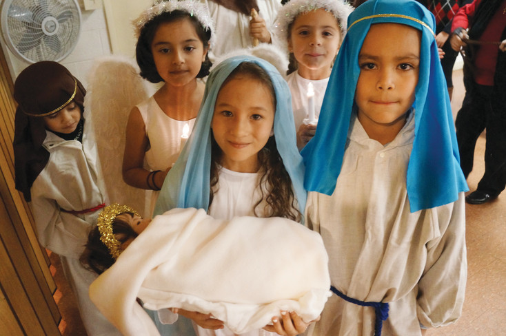 Students re-enact the Nativity for Christmas 2013 at Our Lady of Visitation Church, just east of Federal on 53rd Place. The Archdiocese of Denver, citing a difficult decision based on changing demographics and needs of its Catholic population, ended Sunday Masses there in April.
