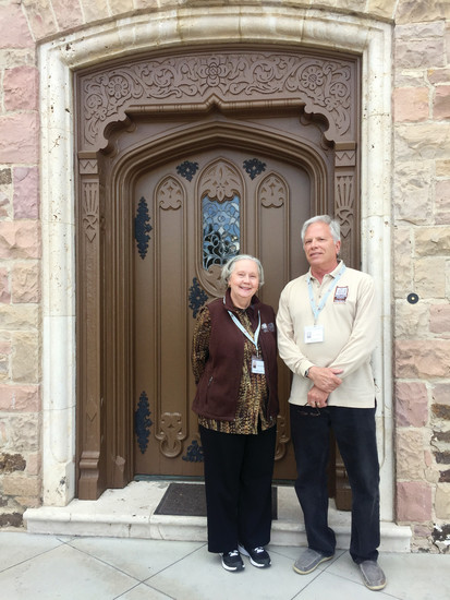 Highlands Ranch Mansion volunteers Peggy Breeding, left, and Todd Noreen stand before the grand entrance of the historic building at 9950 E. Gateway Drive. They spend a couple of hours one day a week interacting with guests and leading tours.
