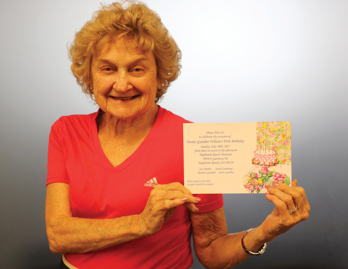 Yvette Wilson holds up an invitation to her 95th birthday celebration at the Highlands Ranch Mansion.
