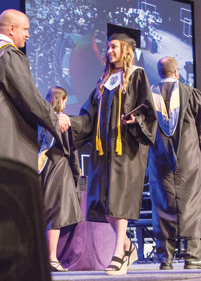 Lutheran High School Valedictorian Stephanie Norris receives her diploma from Head of School Dan Gehrke during the school's commencement ceremony on May 26. Four valedictorians, Norris, Cruz Haney, Hannah Holm and Cody Schauer all spoke to the families and students assembled.